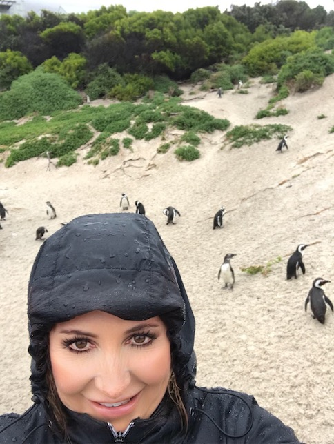 Stephanie Bell on the beach with penguins