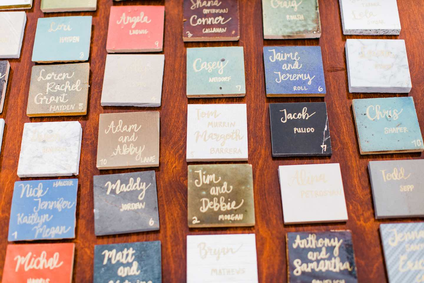 tile samples with handwritten names