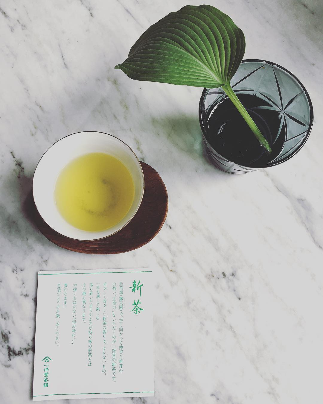 cup of japanese green tea on marble surface