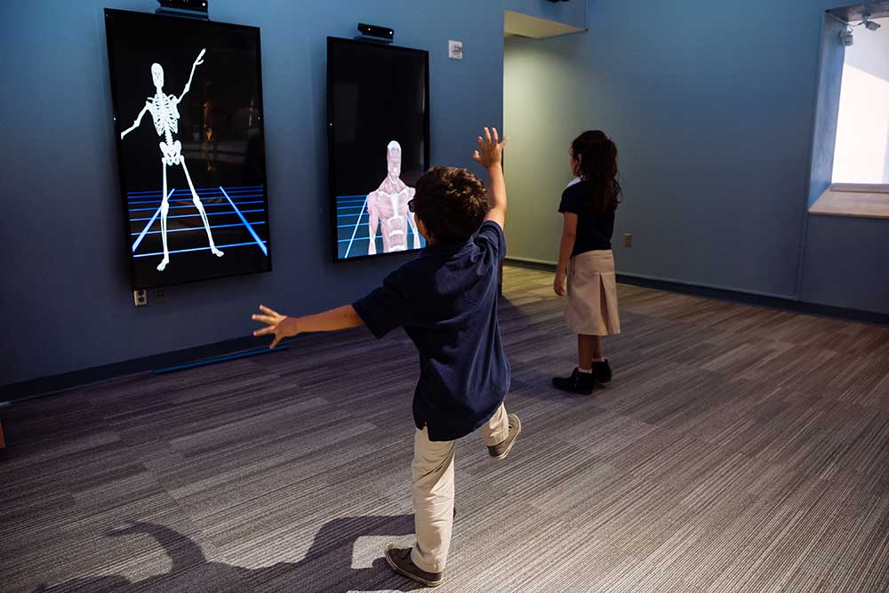 children interacting with digital installation
