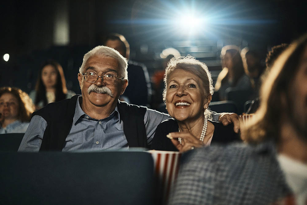 older couple enjoying a movie