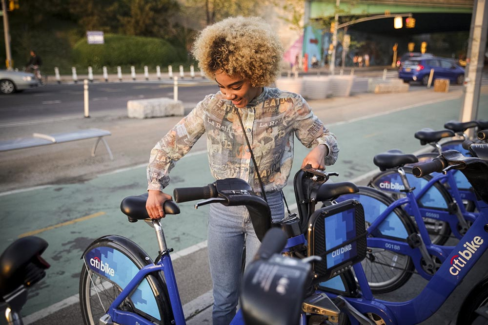 young woman undocking a citibike
