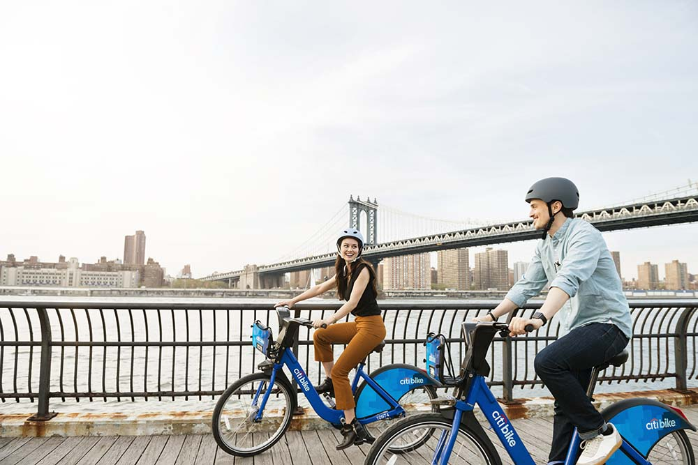 couple riding citibikes