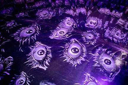 graphics of eyes on a purple toned floor