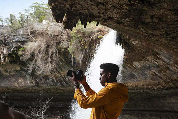 Karl Shakur photographing a waterfall