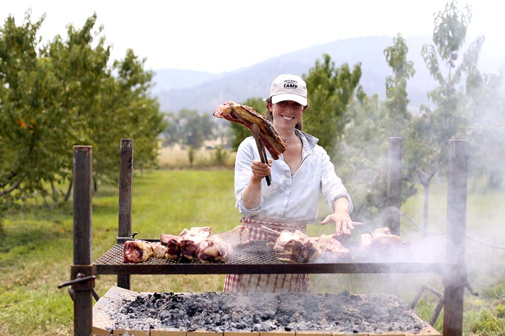 woman grilling meat