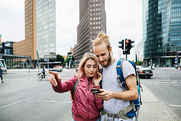 couple referring to mobile device for directions in an urban area