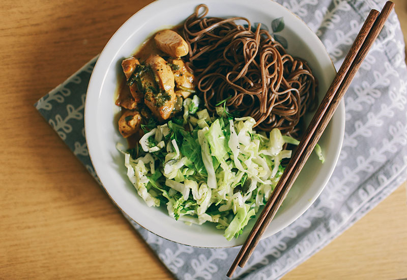 traditional japanese food buckwheat soba curry and vegetable salad with greens