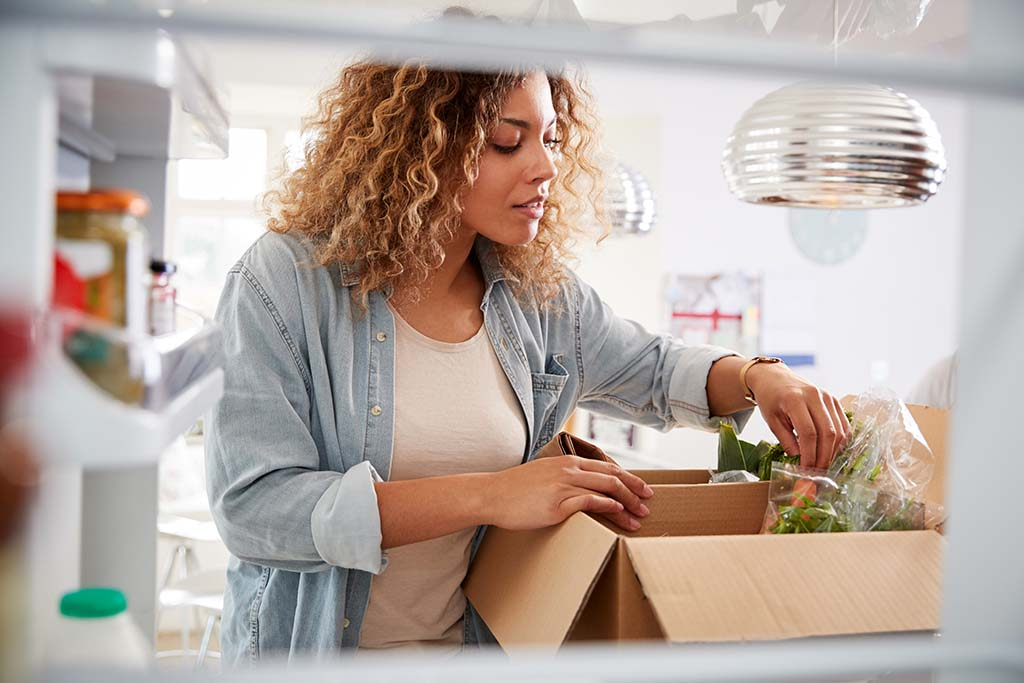 Woman Unpacks Online Home Food Delivery